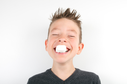 Boy eating marshmallow