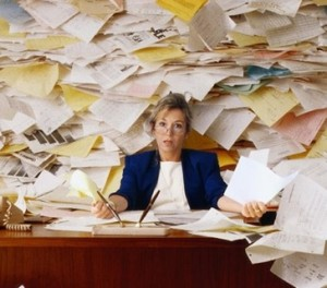 woman surrounded with papers