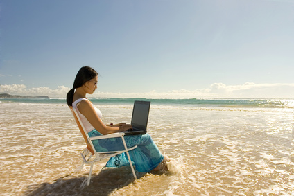 woman writing on laptop in ocean