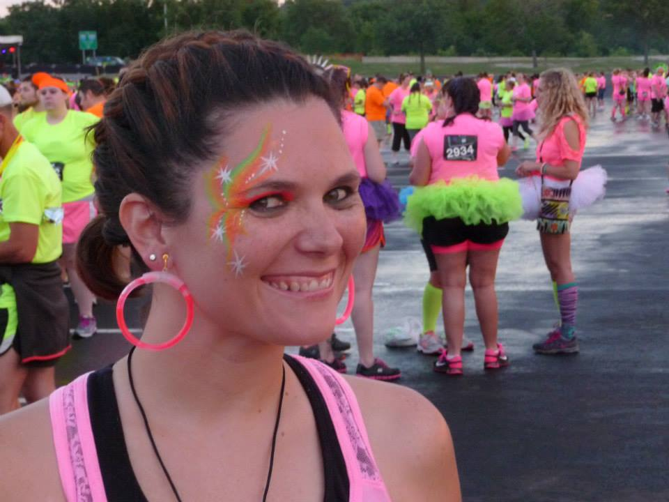 Heather Denney with her cute stars face paint at KC Glow Run 5K